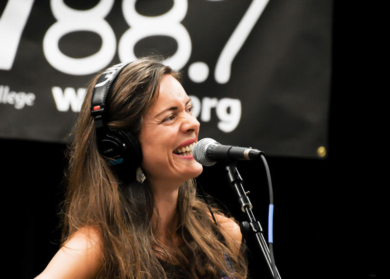 Woman laughing in interview in Studio B at WNCW