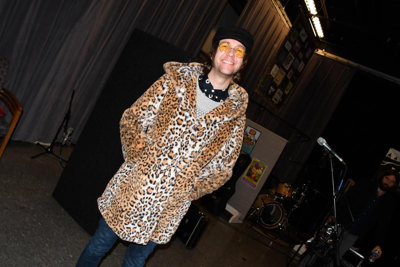 Musician posing in a cool animal print coat