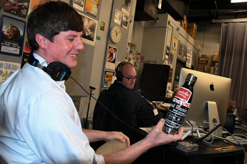 Man smiling holding water bottle