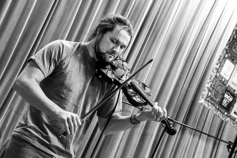 Black and white image of fiddler fiddling