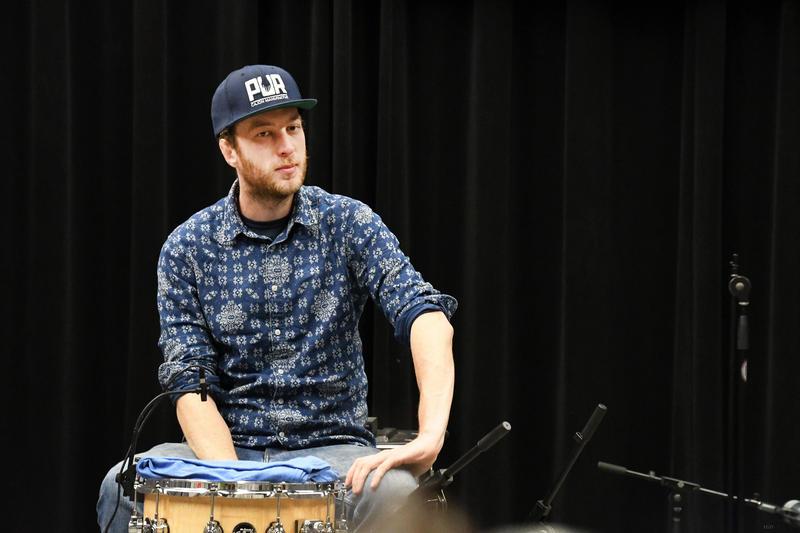 Drummer watching interview