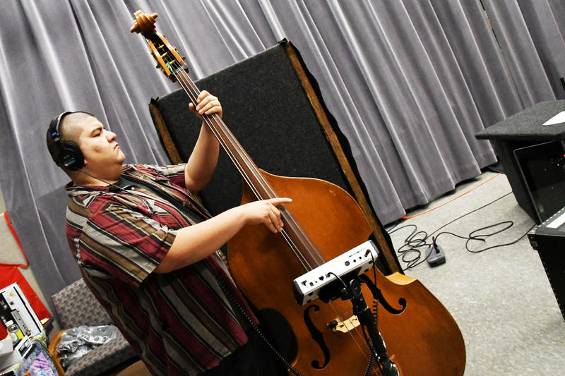 Bass player with stand up bass