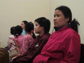 Members of the audience at a church discussion on Burmese refugees