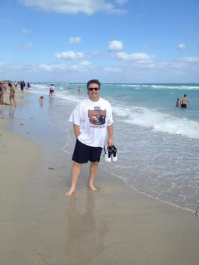 Former NIU football player John Ivanic soaks in the Florida sun before tonight's game