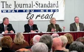 George Gaulrapp, Jim Gitz, Bettye Corbin, and Jon Staben work to impress the voters at a mayoral candidates' forum at Highland Community College in Freeport.