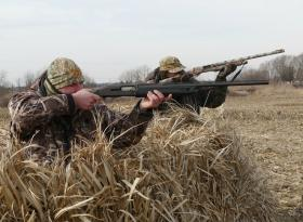 Hunters Mike Blaske, 32, foreground, and Scott Early, 63, pose with their shotguns during a late January Canada goose hunt outside of Gardner, Ill., about an hour southwest of Chicago.