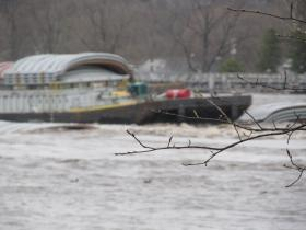 One of nine barges that broke free from their tow and ran up against the Marseilles Dam.