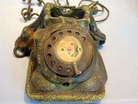 Phone hit by lightning, displayed at Amberely Chalk Pits Museum.