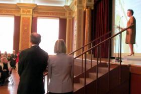 NIU's 12th President Doug Baker and Dana Stover listen as Board of Trustees chair Cherilyn Murer introduces them to the reception crowd at Altgeld Hall.