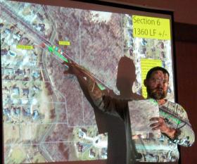 Josh Clark of the DeKalb Park District presents the plan to add plants, shrubs, and prairie along the DeKalb Nature Trail.