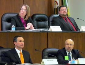 Four candidates for DeKalb Mayor. Clockwise, starting from upper left:  : Jennifer Groce, David Jacobson, John Rey, and Mike Verbic.