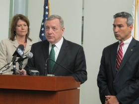 (Left) Rep. Cheri Bustos (Center) U.S. Senator Dick Durbin (Right) Winnebago State's Attorney Joe Bruscato