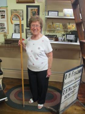 LaVerle Carter poses with the cane of longtime Earlville physician O.H Fischer