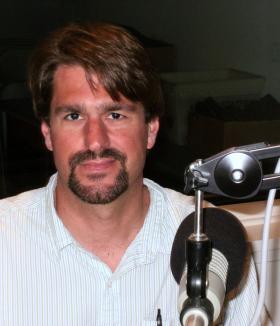 Chris Fink in the WNIJ studios