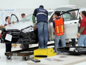 Workers at the Chrysler plant in Belvidere perform in-depth checks on a Dodge Dart.