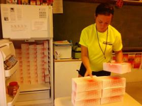 A Rockford volunteer distributes free meals in 2012