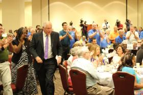Gov. Pat Quinn heads for the stage at a meeting of the Illinois Democratic County Chairmen's Association's annual brunch on Wednesday, Aug. 14, 2013, in Springfield, Ill. (Brian Mackey/Illinois Public Radio)