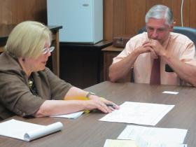 DeKalb Library Director Dee Coover goes over building plans with Rep. Bob Pritchard