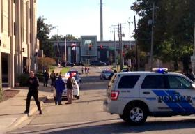 NIU police block access to the campus parking garage Friday afternoon after a young woman jumped to her death.