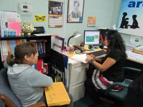 Veronica Martinez helps an Aurora woman enroll into the health insurance marketplace