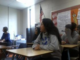 Juliana Solis (centered) watches a film in class