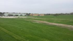 """The """"North 40"""" land behind the NIU Business building and the Engineering building. Options include adding parking or new facilities, or simply maintaining the open space."""