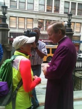 Ness being greeted by Bishop Dorsey McConnell on the steps of Trinity Cathedral in Pittsburgh