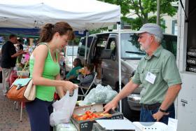 Farmer David Woodruff with a customer at the Woodstock Farmers Market in 2013