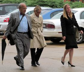 """Rita Crundwell leaves the federal courthouse in Rockford with her attorneys after initially pleading """"not guilty"""" in May 2012."""