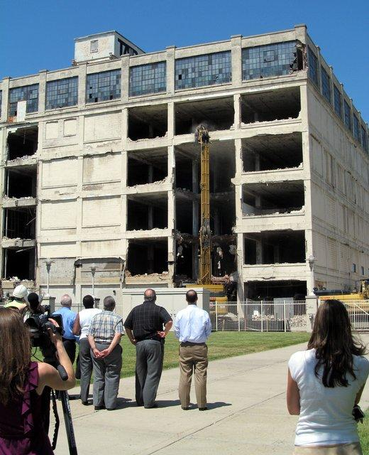 People gather for the beginning of the demolition of the Tapco Building in downtown Rockford.