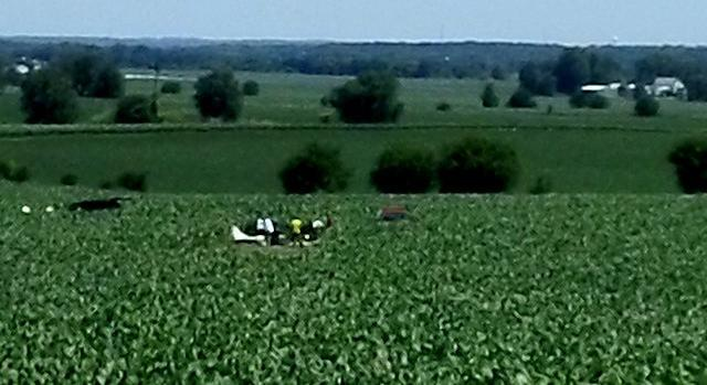 A Lancair 235M lies in a cornfield near Monroe Center. The pilot was killed when the plane caught fire and crashed Tuesday.