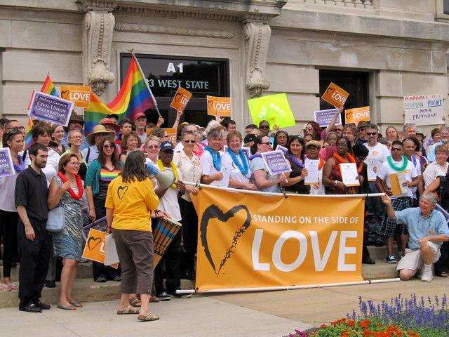 The crowd poses on the DeKalb County Courthouse steps after a short march in support of civil unions.