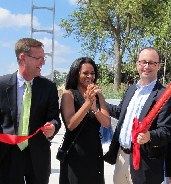 Alderman Doug Mark, Illinois Transportation Department's Marva Boyd, and Mayor Larry Morrissey at riverfront ribbon-cutting.