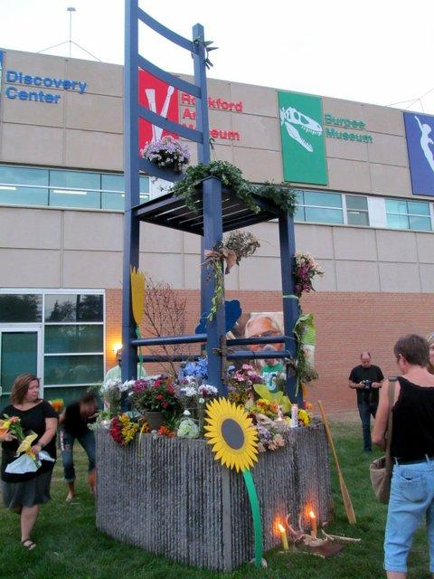 Friends gathered Tuesday night and transformed The Big Chair at Rockford's Riverfront Museum Park into a memorial for artist Jim Julin.