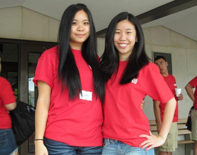 Eunice Lee and Catherine Cheng welcome fellow Huskies to LIncoln Hall.