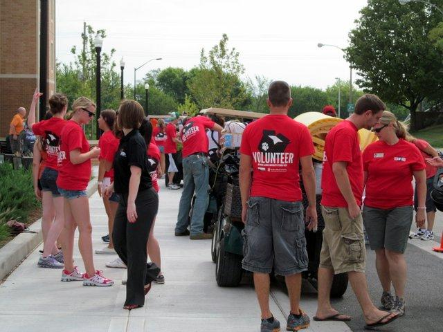 Volunteers swarm outside NIU's new residence hall.