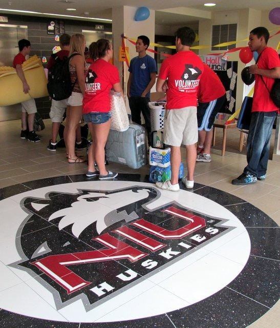 Students helping students move into NIU's newest residence hall.