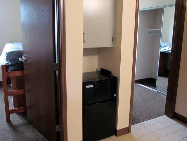 NIU's new residence hall's residents get their own bedrooms.