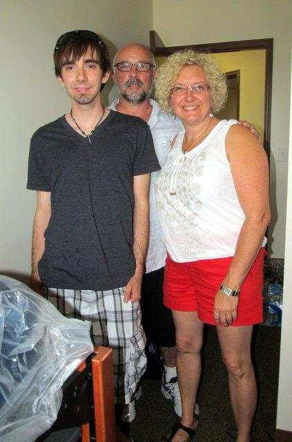 Nate Stalle of Crystal Lake in his new home, with parents Kathy and John.