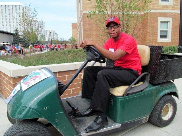 Student Association President Delonte LeFlore takes a tiny break during a long day of cart-driving and stuff-hauling for his fellow NIU students.