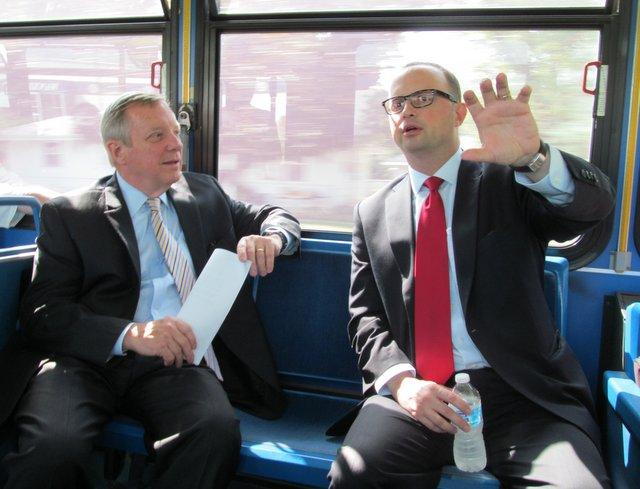 Rockford Mayor Larry Morrissey shows Senator Dick Durbin some of the growing businesses near Rockford's airport during a bumpy bus ride.