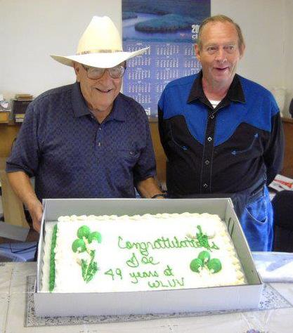 Songwriter/performer Gary Mullis helps WLUV owner Joe Salvi cut the cake on the station's 49th birthday in 2011.
