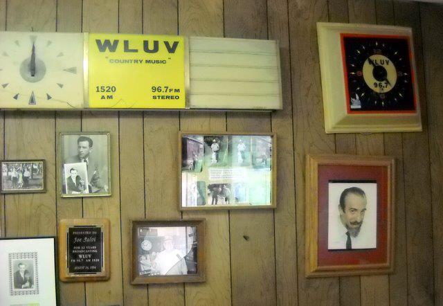 Name-brand clocks and Sing-Along With Mitch Miller grace the lobby walls at WLUV.