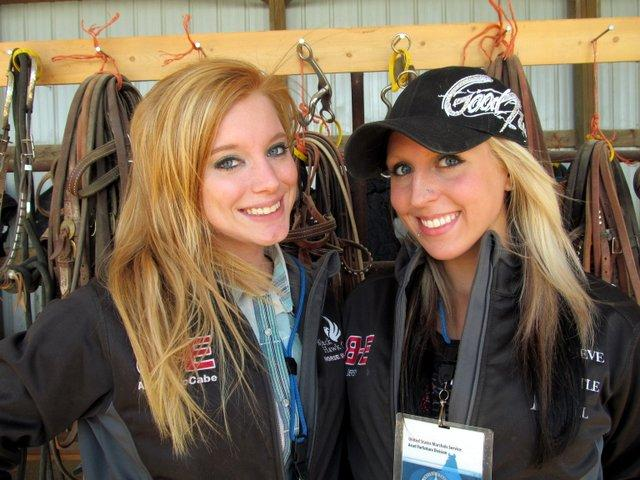 Blackhawk College equestrians Abbie McCabe and Courtney Ewing working at the Rita Crundwell horse auction.