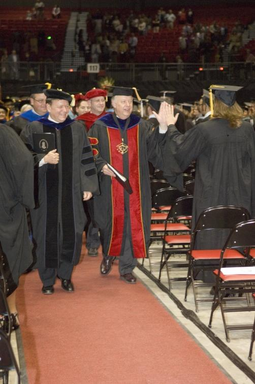 "A ""high five"" for a graduate at NIU commencement ceremonies"