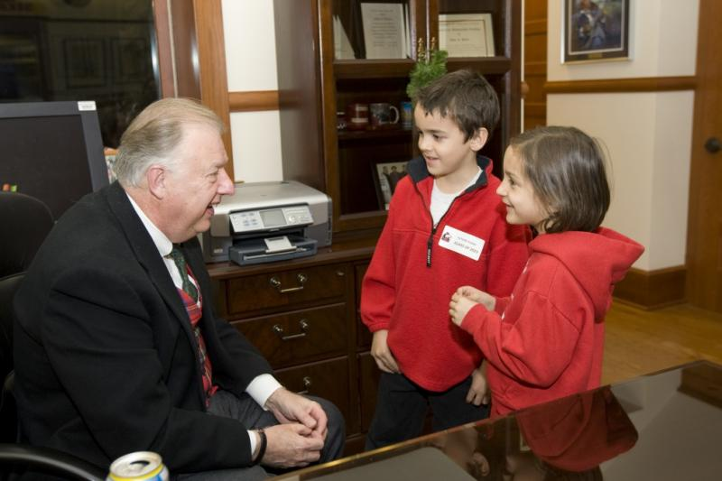 Dr. Peters chats with future students in his office