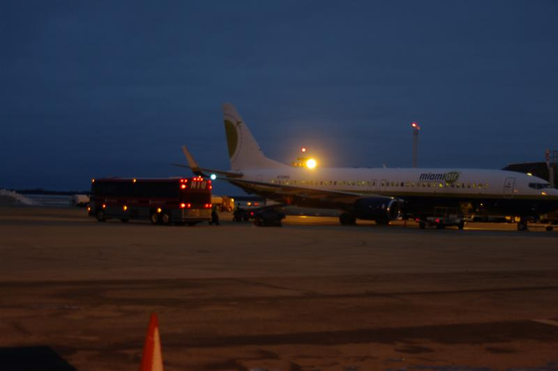 The NIU Huskies football team sits aboard a Miami Air 737 charter plane waiting for takeoff. The team and several university supporters boarded at Chicago Rockford International Airport about 6:30 a.m. Wednesday for the flight to the Orange Bowl