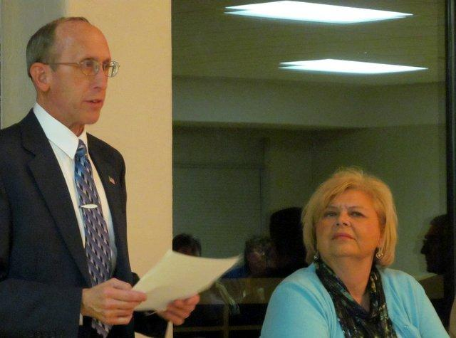 ComEd's Paul Callighan speaks as DeKalb Park District Board President Joan Berkes-Hanson listens at a December meeting.