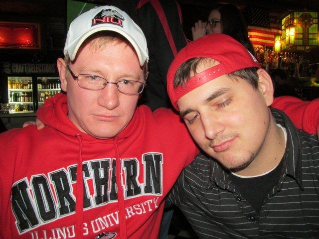 John and Brian try hard to express their disappointment at the Huskies' loss.