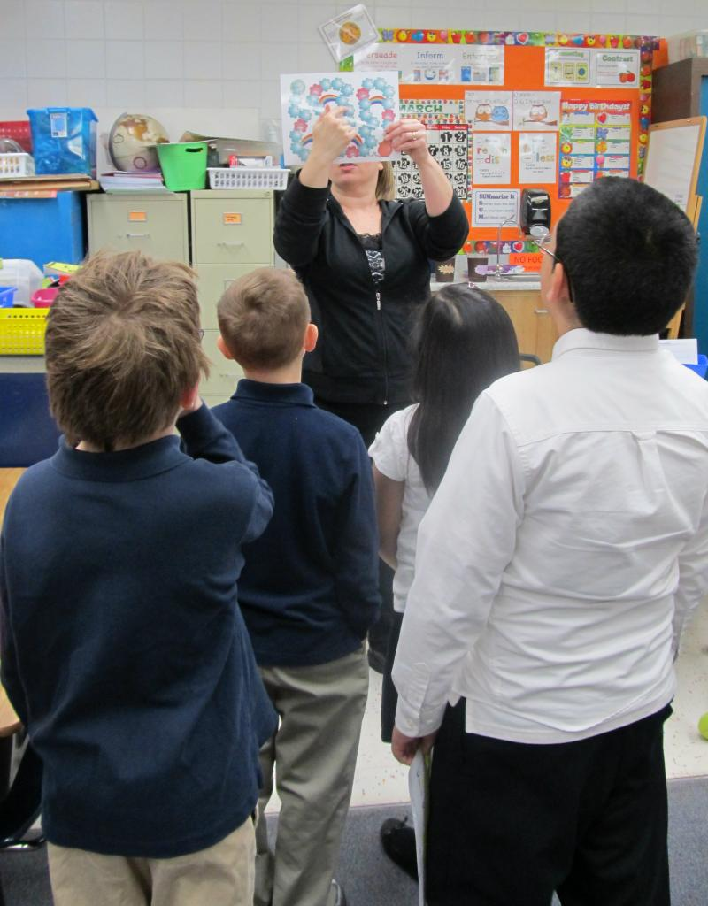 Freeport teacher Michele Downing shows students a math activity